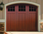 We have vinyl garage doors that look like wood.