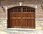 Wood garage doors can be finished to perfectly match the exterior of your home